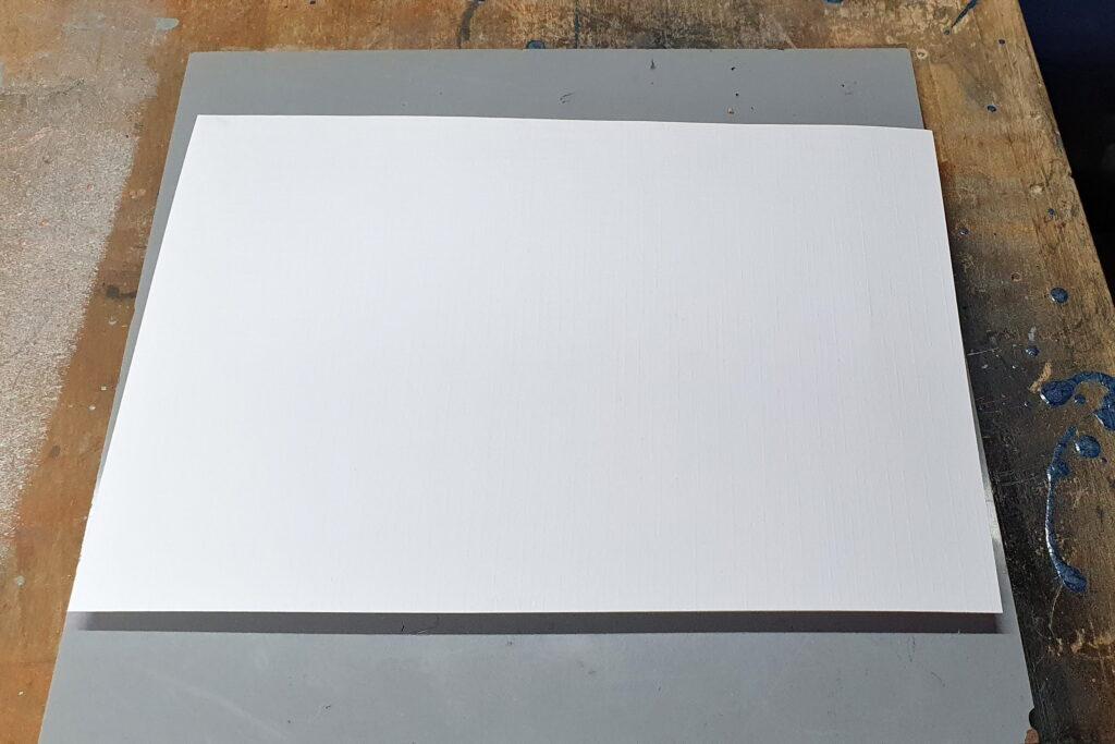 Papier auflegen und gleich leicht andrücken